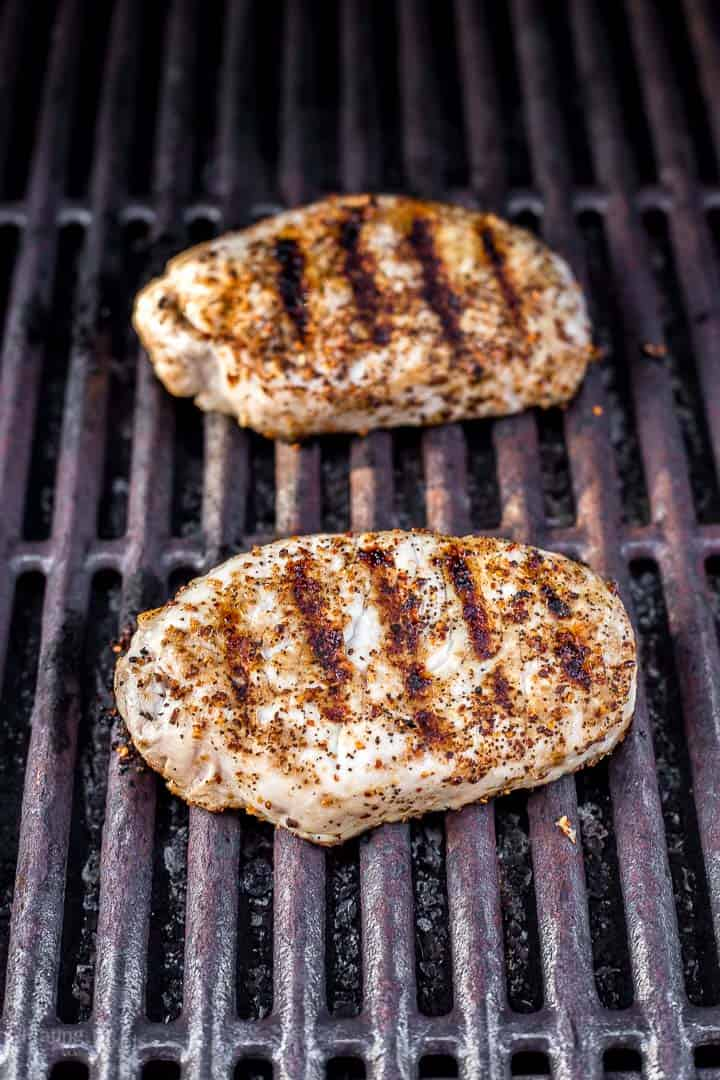 Two boneless in pork chops on grill with sear marks