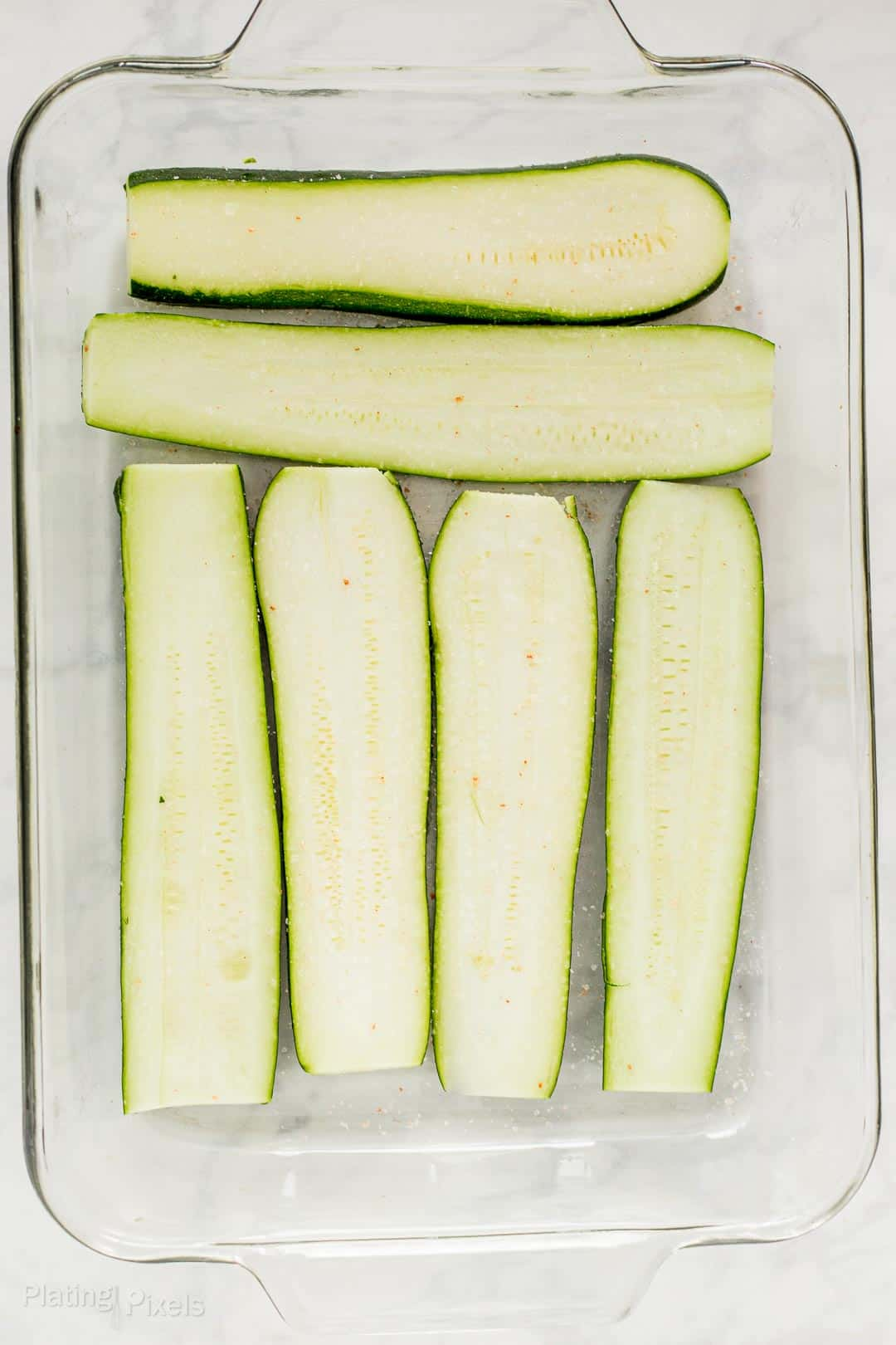 Layer of zucchini slices in a glass baking dish