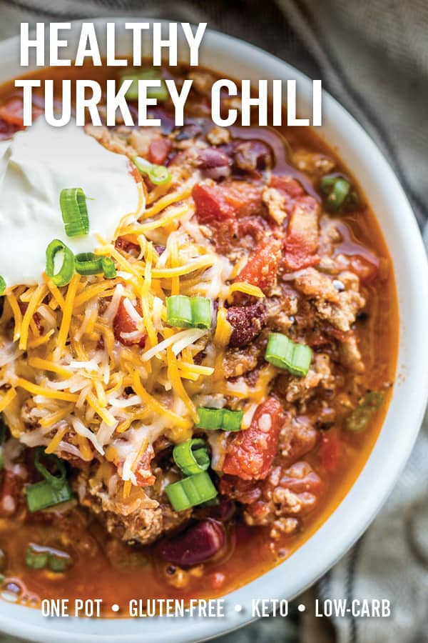 Wholesome classic healthy turkey chili loaded with flavor from simple ingredients commonly found in your pantry. This gluten-free chili is made in one pot and ready in less than 30 minutes for an easy weeknight meal. #turkeychili #chili #healthychili #comfortfood