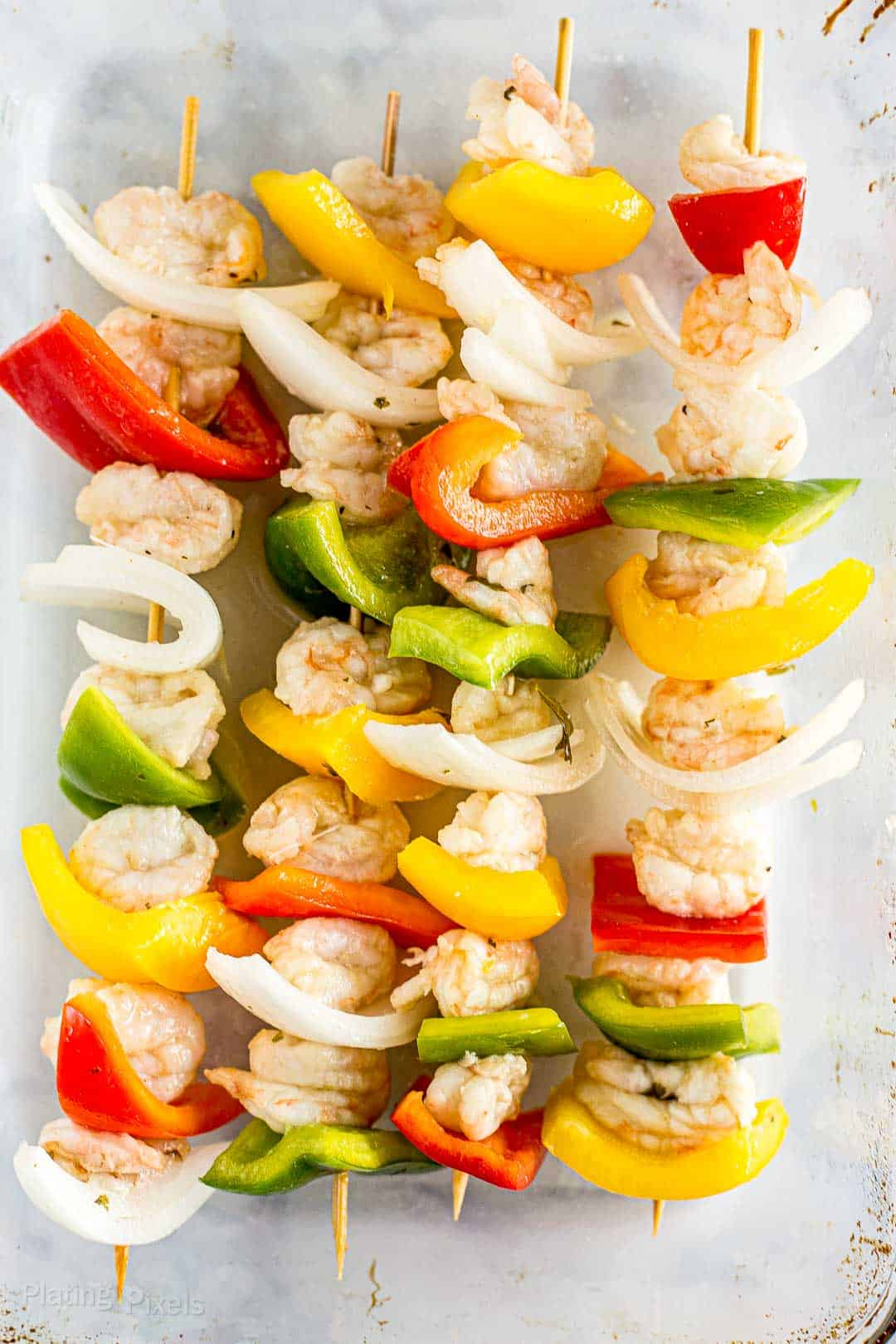 Easy Grilled Shrimp Fajitas Skewers with a delicious homemade fajita marinade that includes lime, soy sauce, red wine vinegar, garlic, jalapenos, and spices with bell peppers and onion. These are bursting with flavor and a wholesome way to enjoy fajitas. #shrimpfajitas #shrimp #grilledfajitas #fajitas