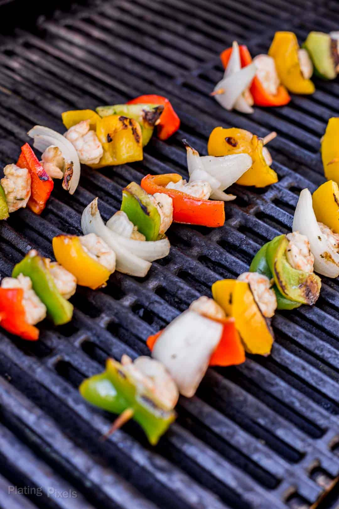Shrimp Fajitas Skewers cooking on a gas grill