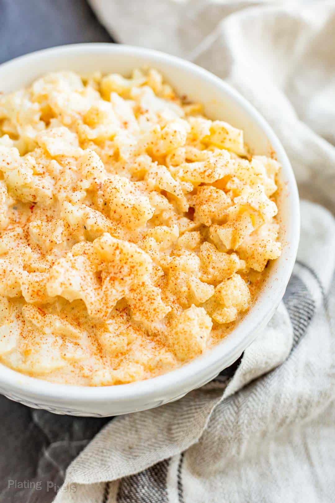Keto Cauliflower Mac and Cheese garnished with paprika