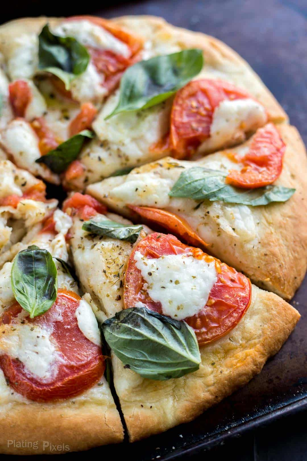 Close up of Caprese pizza cut into slices