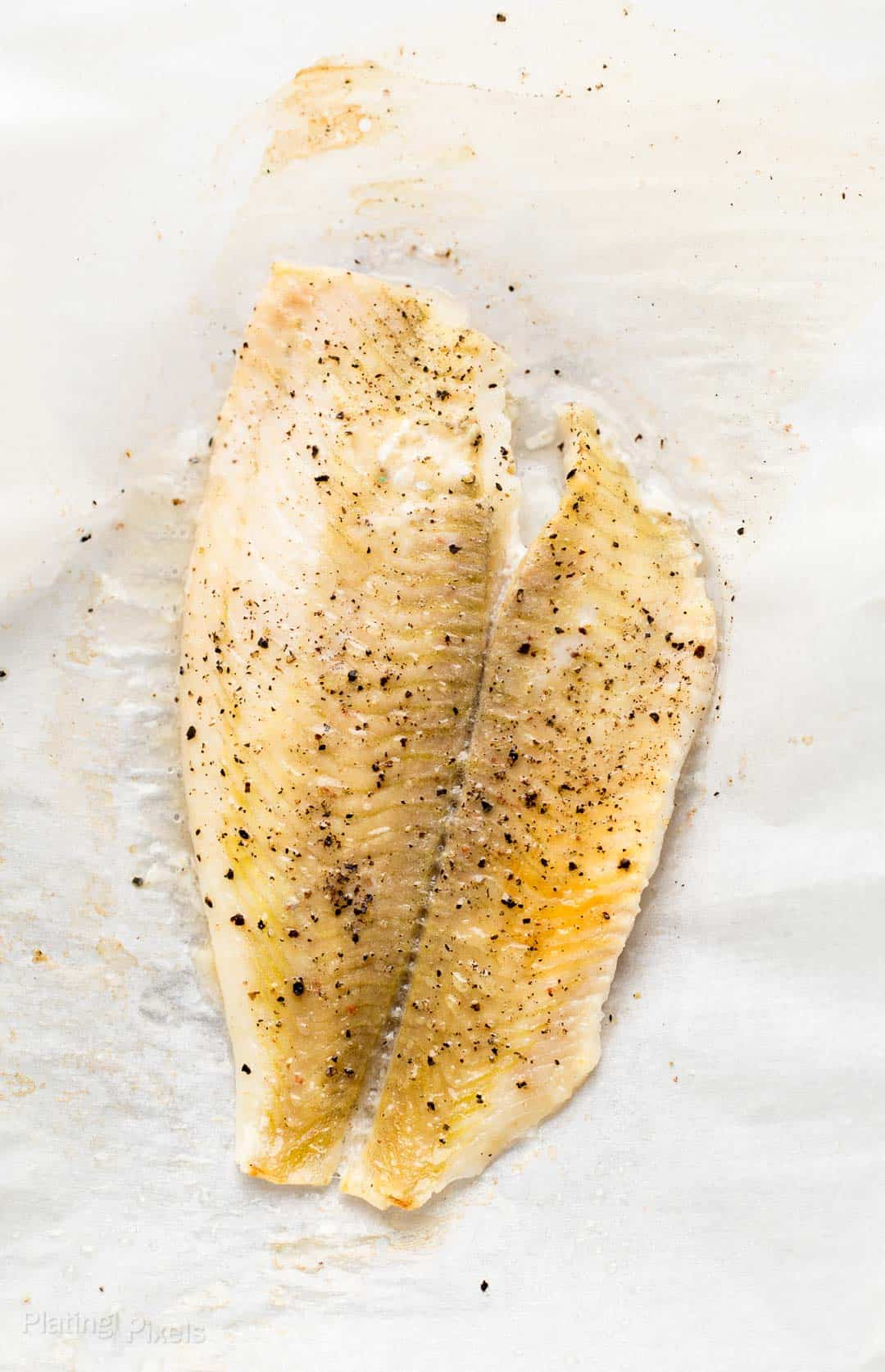 Baked Tilapia fish on a baking pan