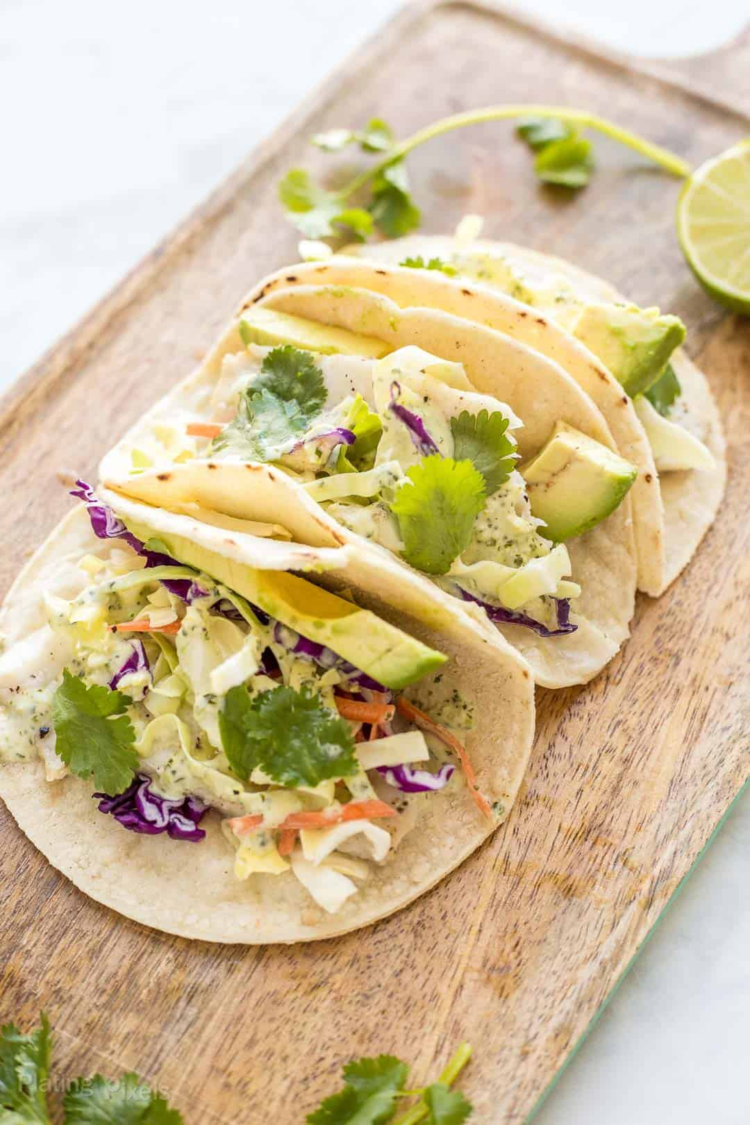 Angled shot of three Baked Fish Tacos with Cilantro Dressing