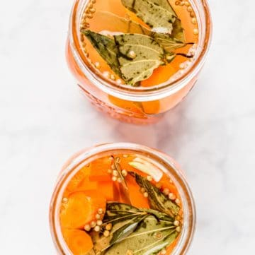 Overhead shot of two mason jars of Lacto Fermented Carrots