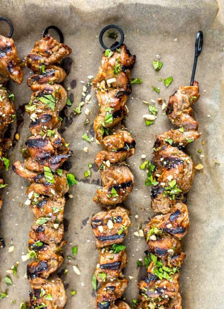 Close up of grilled pork satay on skewers