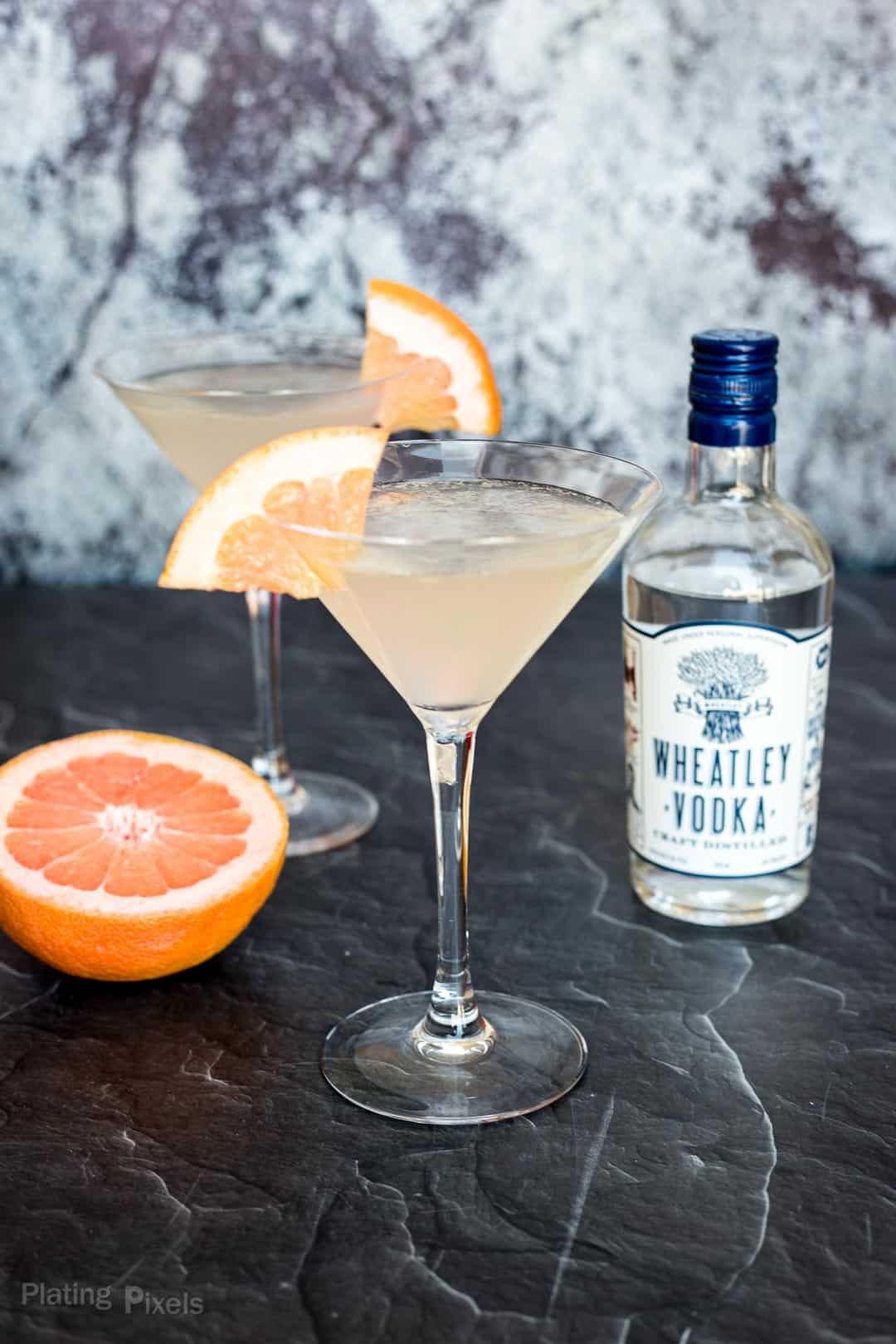 Prepared Grapefruit Martinis next to a bottle of Wheatley Vodka