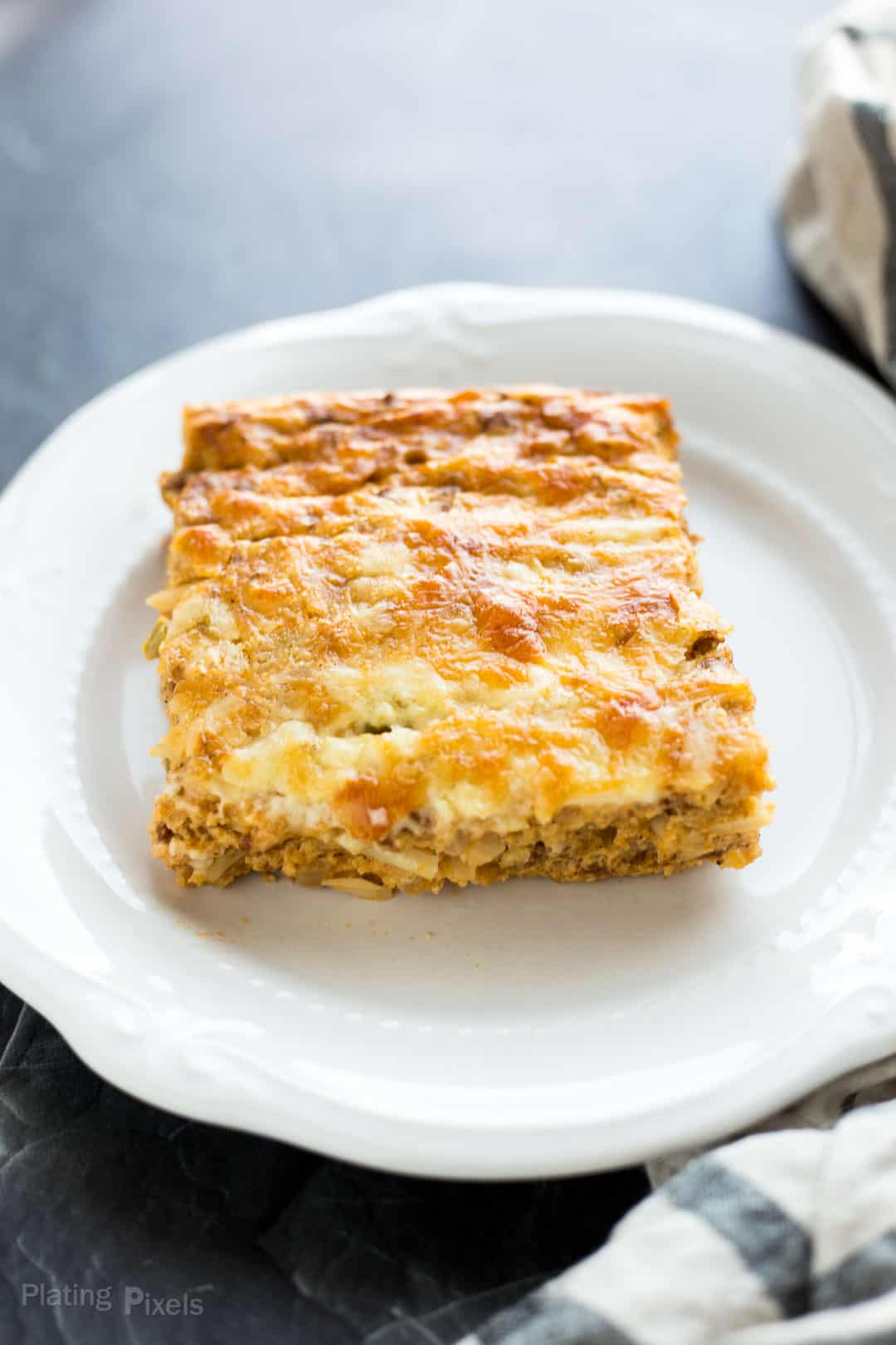 Cut square of a Hash Brown Breakfast Casserole on a plate