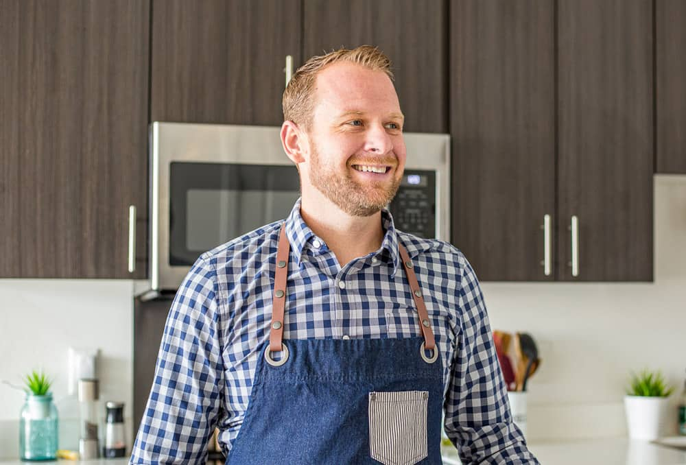 Matt Ivan of Plating Pixels smiling in the kitchen