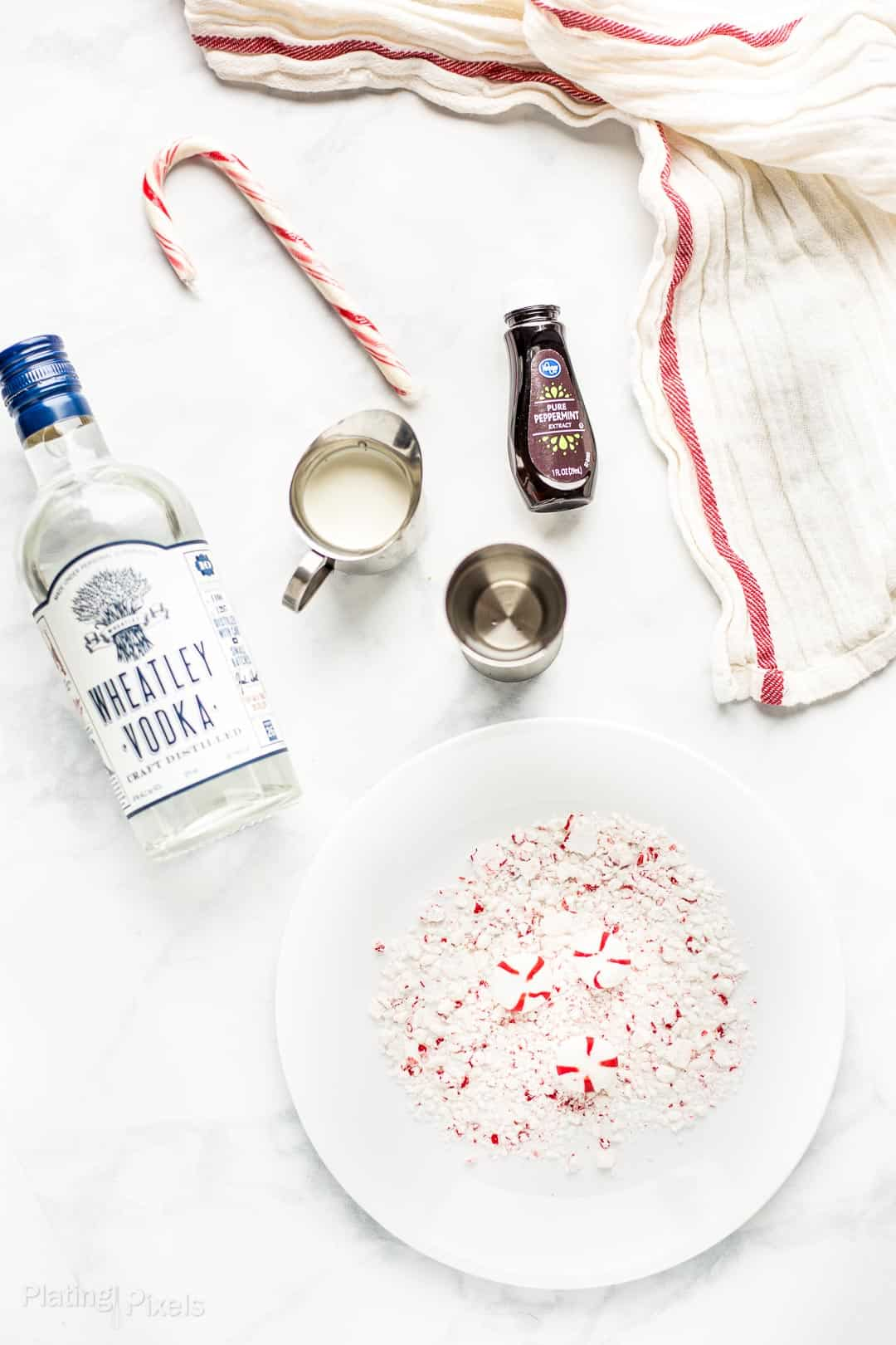 Ingredients to make a White Chocolate Peppermint Martini prepared on a counter