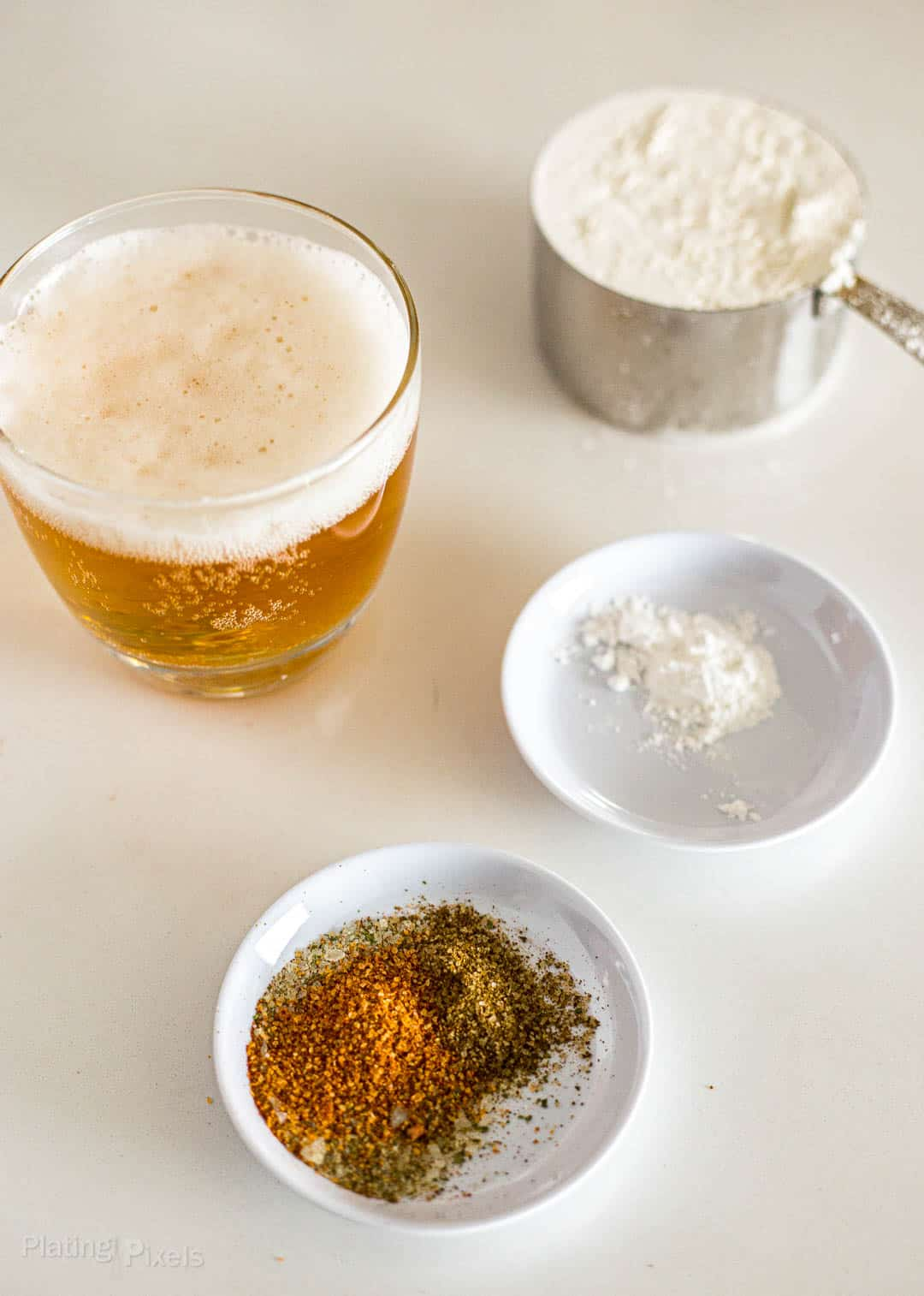 Ingredients to make beer batter on a counter
