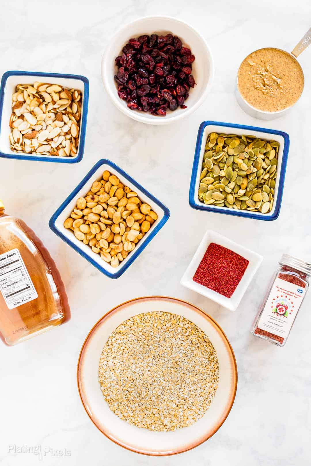 Ingredients for Cranberry Almond Granola Bars prepared on a counter