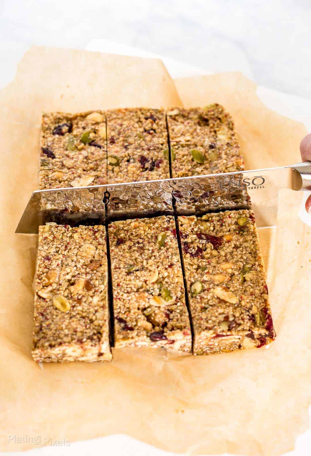 Using a knife to cut Cranberry Almond Granola Bars