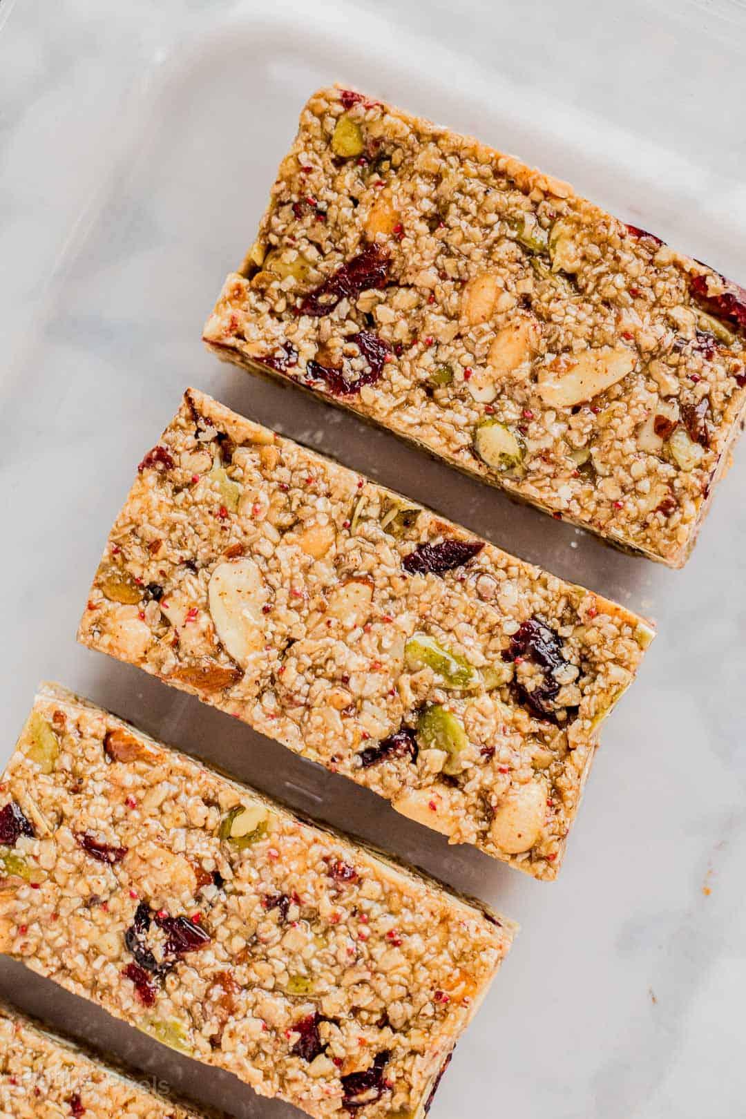 Cut Cranberry Almond Granola Bars on parchment paper