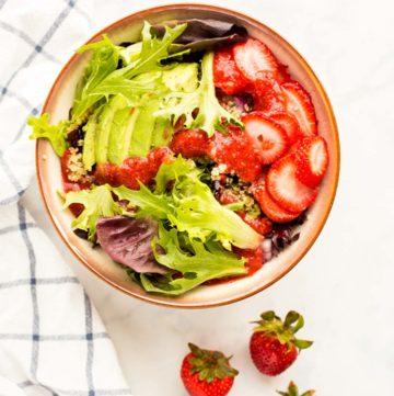 Prepared Summer Strawberry Salad next to fresh stawberries