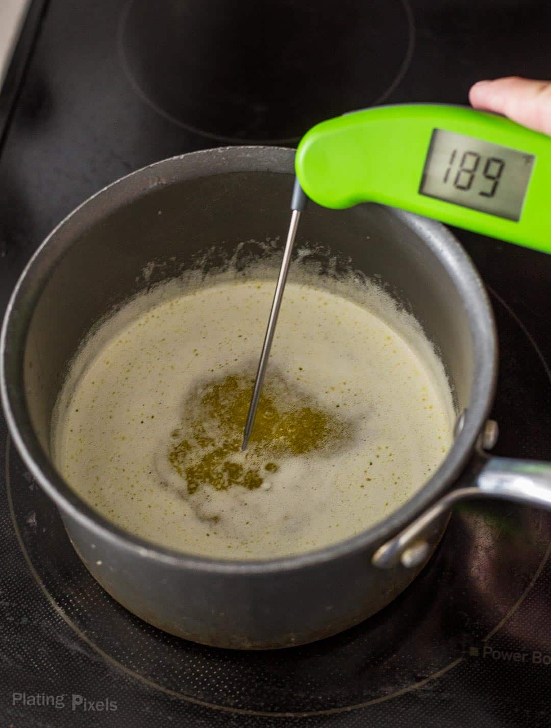 Using an instant-read thermometer to check temperature of melted butter